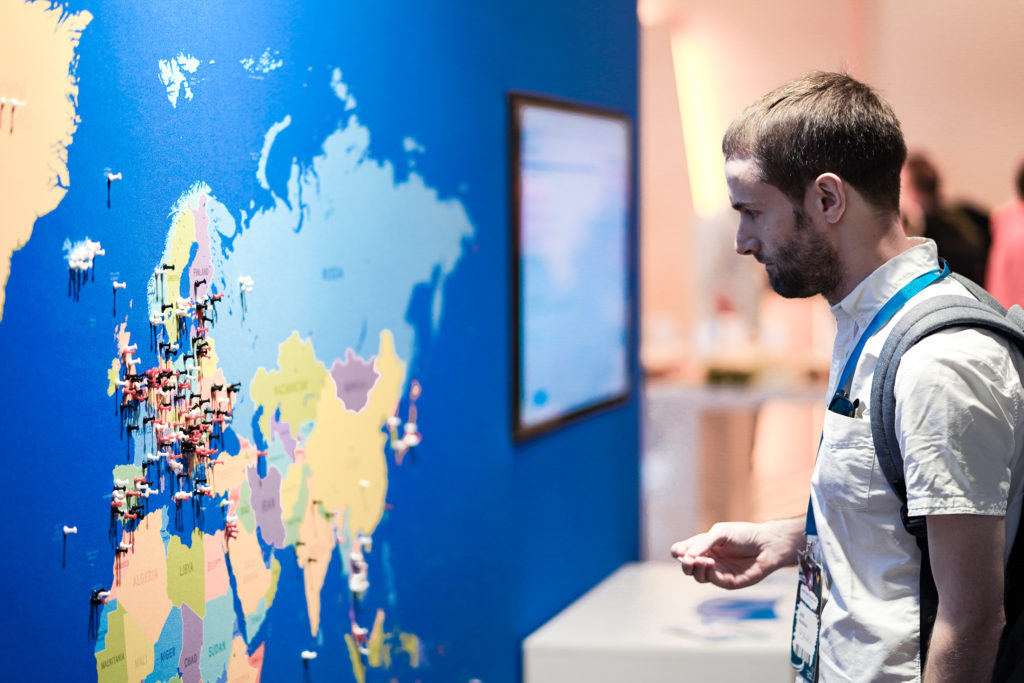 Man Looking at a map the world